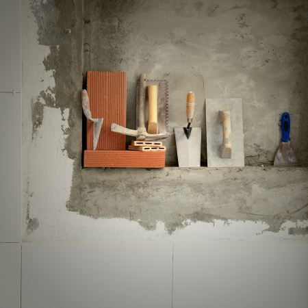 Construction mason cement mortar tools in a row