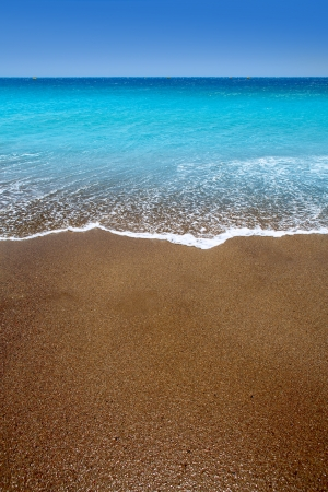 Canary Islands brown sand beach and tropical turquoise water