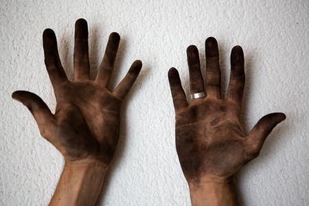black dirty man hands open palms on white background