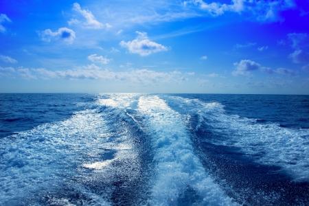Boat wake speedy prop wash foam in blue sky at Mediterranean
