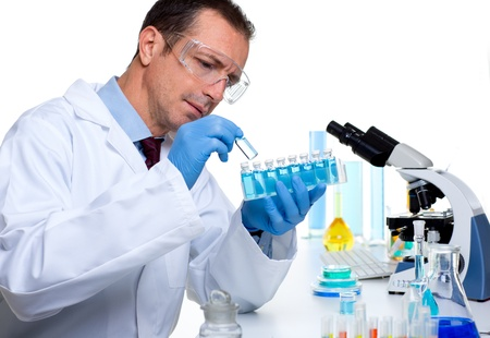 laboratory scientist working at lab with test tubes and microscope