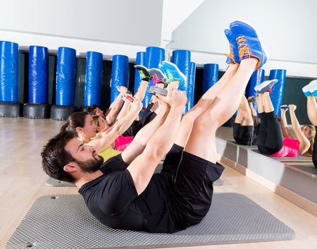 Abdominal plate training core group at gym fitness workout