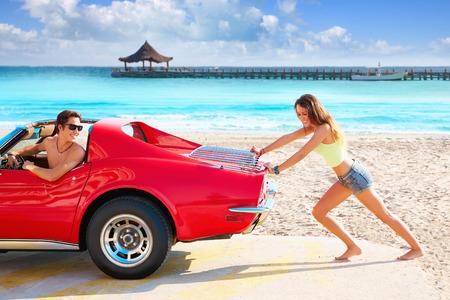 Girl pushing a broken car on the tropical beach funny guy photo mount