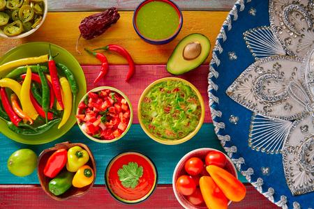 Mexican food mixed guacamole nachos chili sauce dipping cheddar cheese lemon pico de gallo