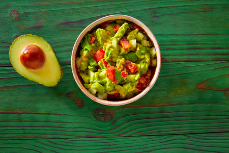 Guacamole with avocado and tomatoes mexican food