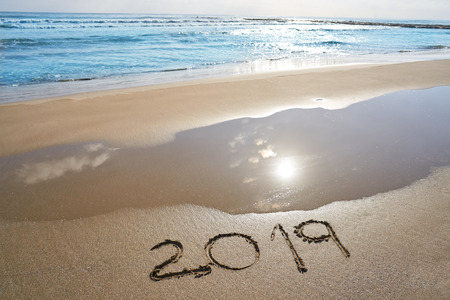year 2019 numbers spell written on beach sand shore