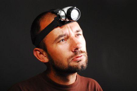 Man With Led Headlamp