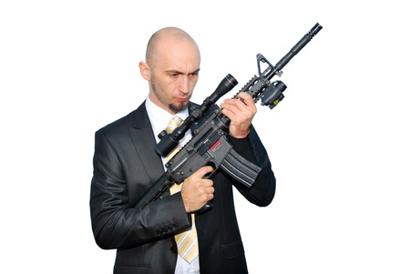Businessman bodyguard isolated on a white background with a big gun
