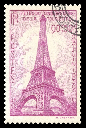 Vintage 1939, France postage stamp showing an engraved image of the Eiffel Tower in Paris, France