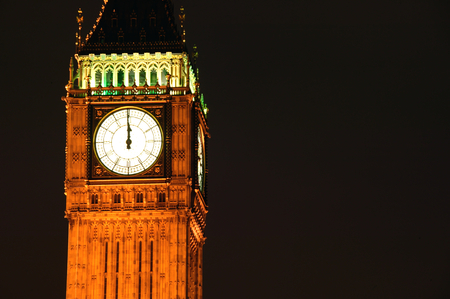 Big Ben clock tower of the Houses Of Parliament in Westminster, London, England, UK  at midnight on New Years Eve, which was built on the site of the Royal Palace Of Westminster in a Gothic style after a fire in 1834