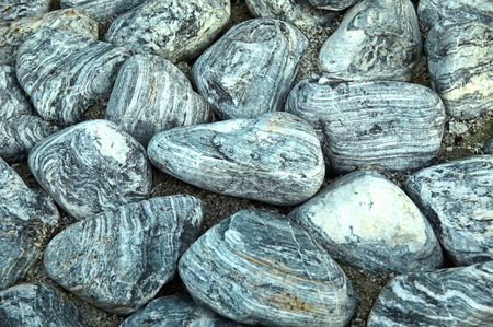 Background of grey black, rock pebble stones used for landscaping