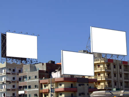 Three blank billboards with space to place your own advertising