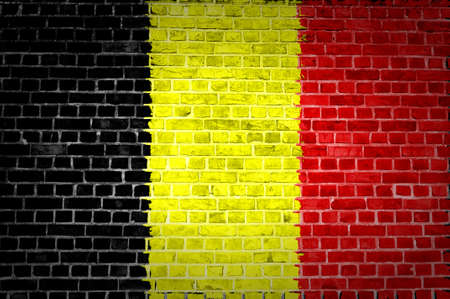 An image of the Belgium flag painted on a brick wall in an urban location