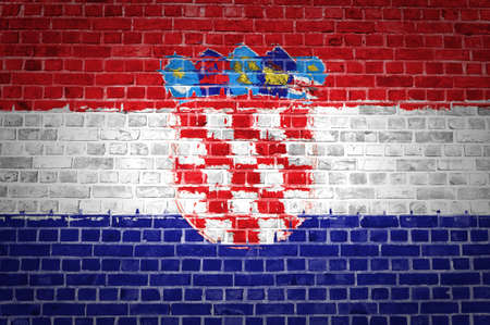 An image of the Croatia flag painted on a brick wall in an urban location