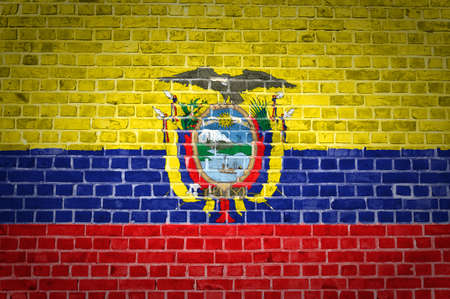 An image of the Ecuador flag painted on a brick wall in an urban location