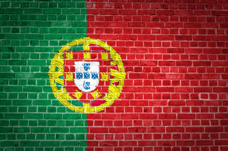 An image of the Portugal flag painted on a brick wall in an urban location
