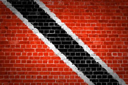 An image of the Trinidad and Tobago flag painted on a brick wall in an urban location