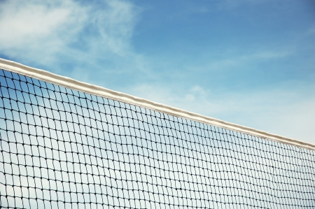 beach volleyball net with blue sky background