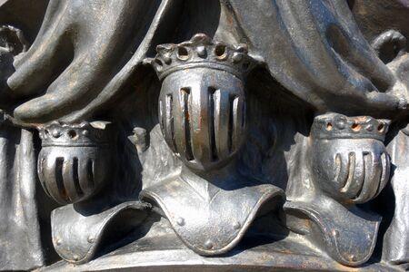 Foto für Cast steel sculpture with three heads of kings in military armor - Lizenzfreies Bild