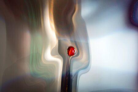 Glass iris on mirrored plastic foil