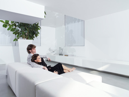 Relaxed young couple at home in bright living room