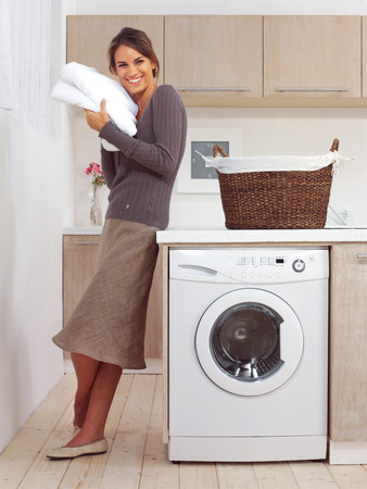 pretty smiling girl in the laundry room l