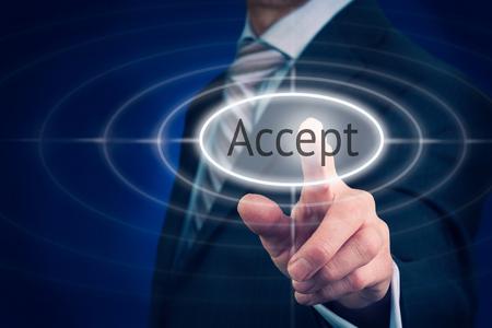Businessman pressing An Accept concept button.