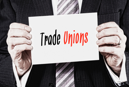Trade Unions, Induction Training headlines concept hold by businessman hands