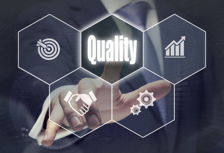 Foto de Businessman pressing a Quality concept button. - Imagen libre de derechos