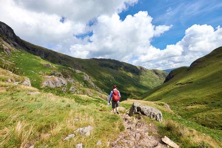 A hiker walking in the English Lake District, UK.
