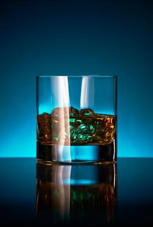 Glass of single malt whisky on a bar.