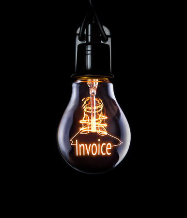 Photo for Hanging lightbulb with glowing Invoice concept. - Royalty Free Image