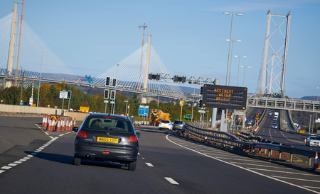 FORTH ROAD BRIDGE, SCOTLAND, UK - NOVEMBER 05, 2016: Traffic approaching the Forth Road Bridge with a sign warning of an accident.