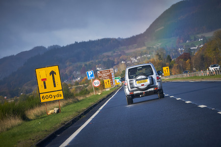 A9 MOTORWAY PITLOCHRY, SCOTLAND, UK - NOVEMBER 05, 2016: A Mitsubishi Shogun approaching roadworks near Pitlochry