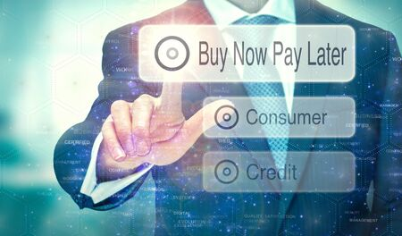 Photo pour A businessman selecting a button on a futuristic display with a Buy Now Pay Later concept written on it. - image libre de droit