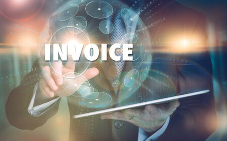 Photo for A hand selecting a Invoice business concept on a futuristic computer display. - Royalty Free Image