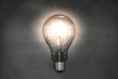 Photo for Image of a light bulb emitting light in a night background - Royalty Free Image