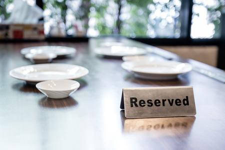 Photo pour Reserver sign on the table inside restaurant - image libre de droit
