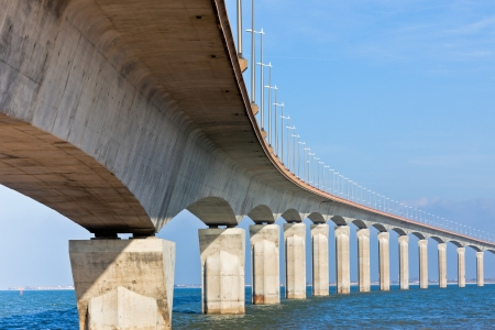 Curved Concrete Bridge over the water. Horizontal shot