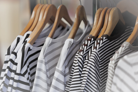 Photo pour Striped Female Pullovers in a Clothing Store. CloseUp shot with small GRIP - image libre de droit