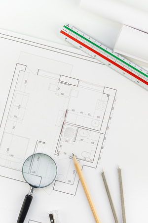 Creative flat lay overhead top view blueprints architectural flat project plan and office supplies on decorator white table workspace with swatches tools and equipment background copy space concept