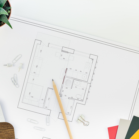 Photo pour Creative flat lay overhead top view blueprints architectural flat project plan and office supplies on decorator square white table workspace swatches tools and equipment background copy space concept - image libre de droit
