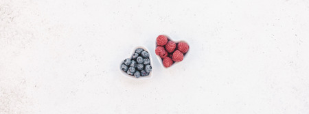 Foto de Creative Valentine Day romantic concept composition flat lay top view love holiday celebration red heart raspberry blueberry table background copy space Template greeting card text social media blogs - Imagen libre de derechos