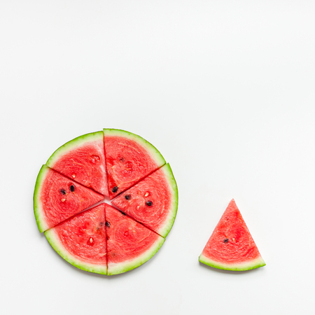 Foto de Creative scandinavian style flat lay top view of fresh watermelon slices on white table background copy space. Minimal summer fruits creative for blog or recipe book - Imagen libre de derechos
