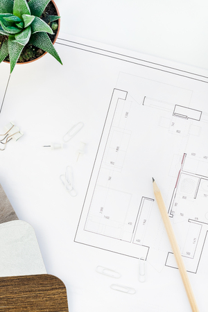 Photo pour Creative flat lay overhead top view blueprints architectural flat project plan and office supplies on decorator white table workspace with swatches tools and equipment background copy space concept - image libre de droit