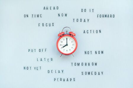 Photo pour Creative top view flat lay of alarm clock with messages about delay or starting doing task copy space blue background minimal style. Concept of procrastination, time management in business and life - image libre de droit