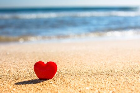 Photo for Valentines Day concept. Romantic love symbol of red heart on the sand beach with copy space. Template for Inspirational compositions and quote postcards. - Royalty Free Image