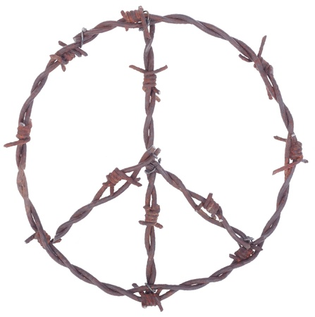 Rusty barbed wire peace sign isolated on white