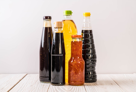 group of sauce bottle condiment for cooking on wood background