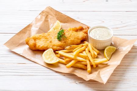 Foto de fish and chips with french fries - unhealthy food - Imagen libre de derechos